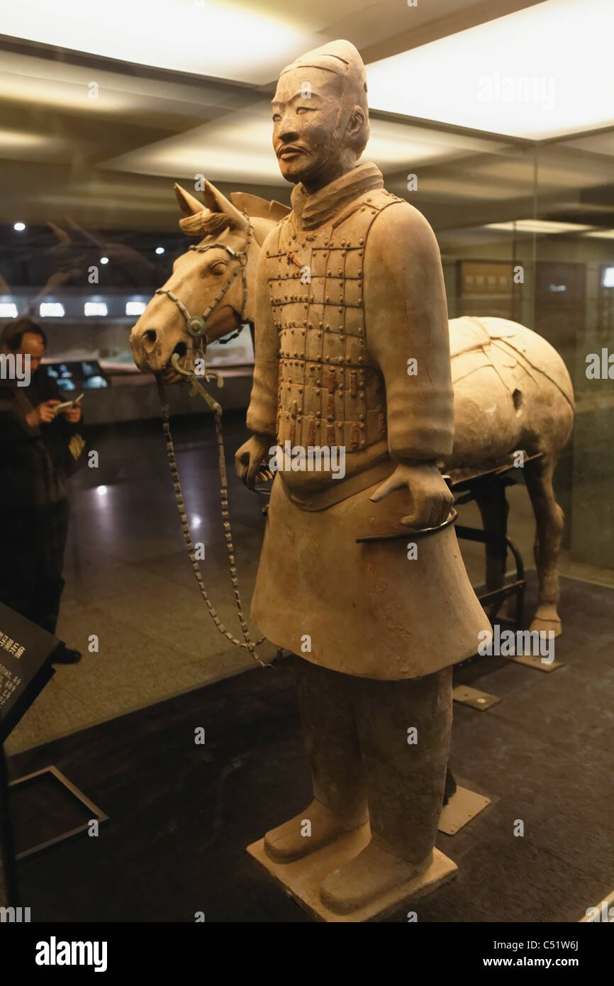 Cavalryman with his horse, Terra-Cotta Solder Figure on Display, Terra-Cotta Warriors and Horses Museum, Shaanxi, - Stock Image