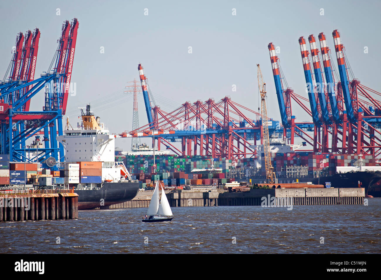 sailing boat and container terminal , Harbour Birthday 2011 in the free and Hanseatic City of Hamburg, Germany - Stock Image