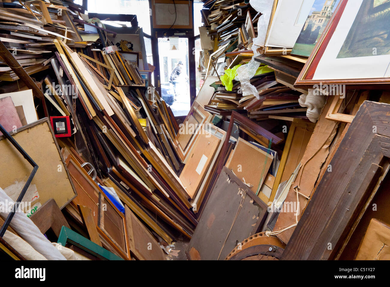 The over-stocked Ryde Framing picture framing shop in Ryde Isle of Wight. JMH5150 - Stock Image