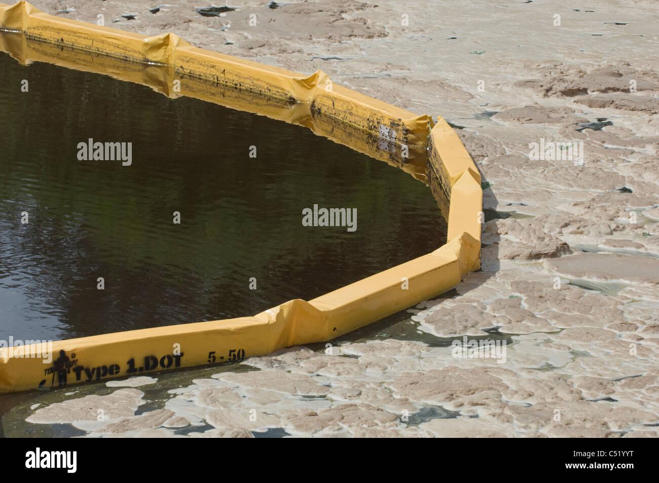 turbidity fence on waterway - Stock Image