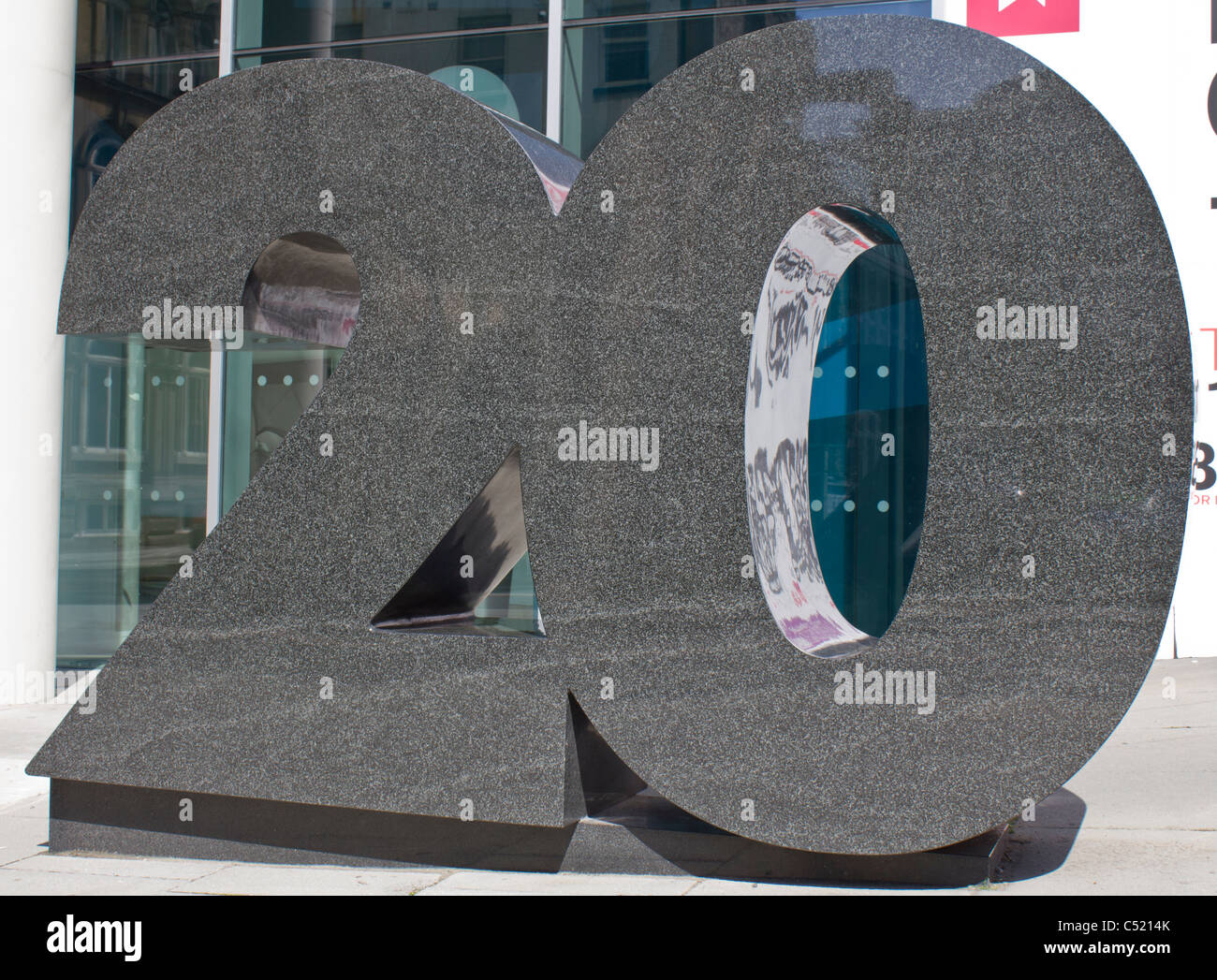 Large sculpture outside a building noting the building number, 20 Stock Photo