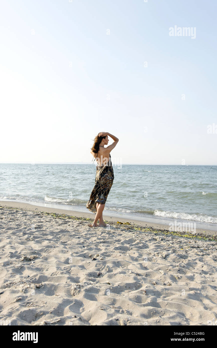 Young woman, 20+, on the beach, lifestyle, sensuality, bikini, swimwear, Niendorf at the Baltic Sea, Schleswig-Holstein, - Stock Image