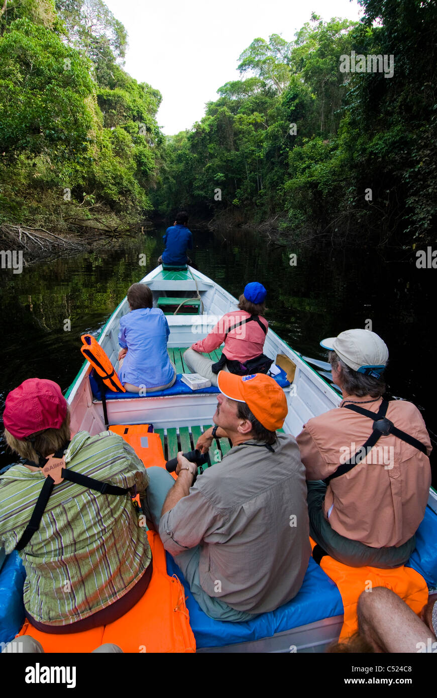 Tourists exploring side channel of Rio El Tigre, Peru; a tributary of the Amazon River - Stock Image