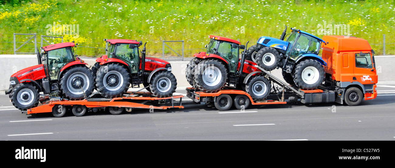 New tractors on low loader lorry and trailer - Stock Image
