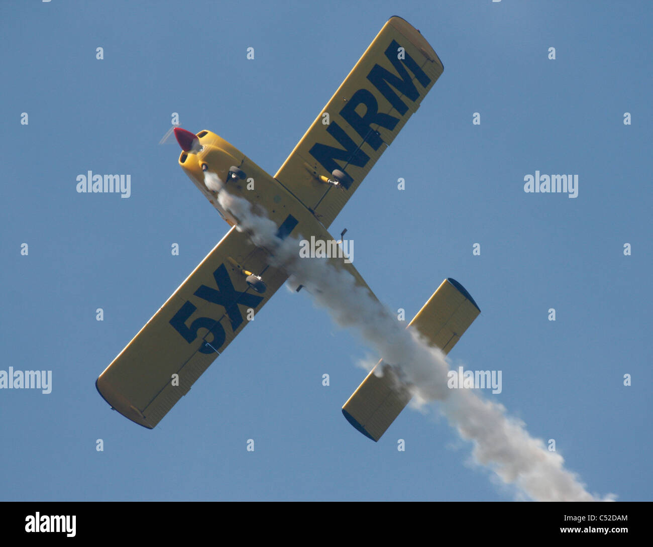 A Fuji FA200 Aero Subaru single engine aerobatic plane spewing smoke - Stock Image