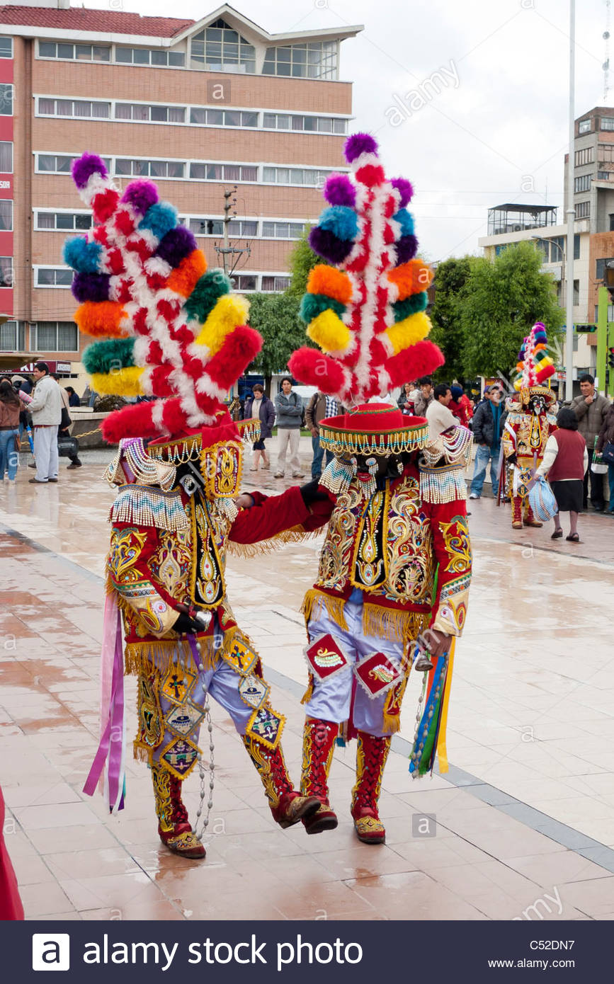 Masked Kapac Negro with large brightly colored headresses and hand-made costumes performing on the Plaza de Armas Stock Photo