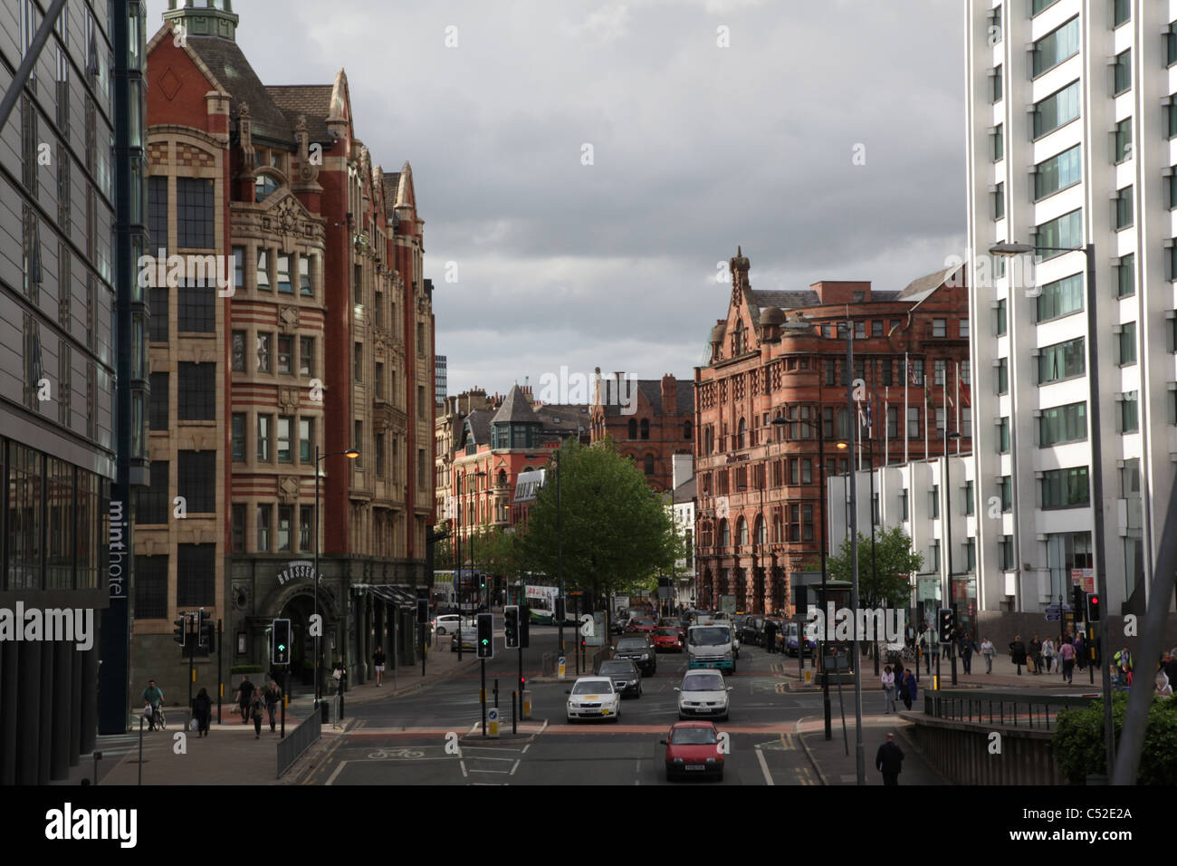 View from footbridge towards Picadilly Train station in the direction of Picadilly Gardens in Manchester - Stock Image