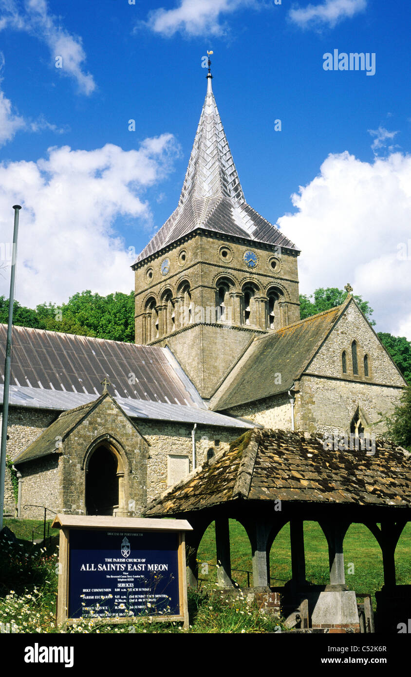 East Meon, All Saints Church, Hampshire England UK English churches Meon Valley central Norman tower towers 12th - Stock Image