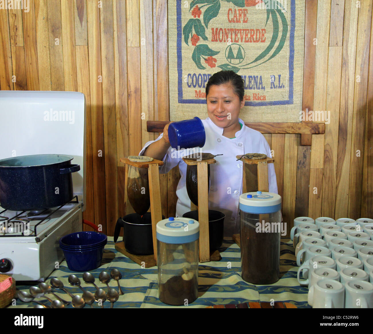 A woman brewing coffee of different strengths, Monteverde, Costa Rica - Stock Image
