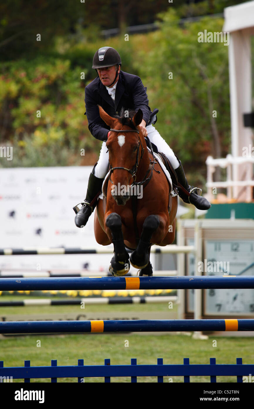 Roger-Yvse Bost from France in action on the horse Nikyta D'Elle. - Stock Image