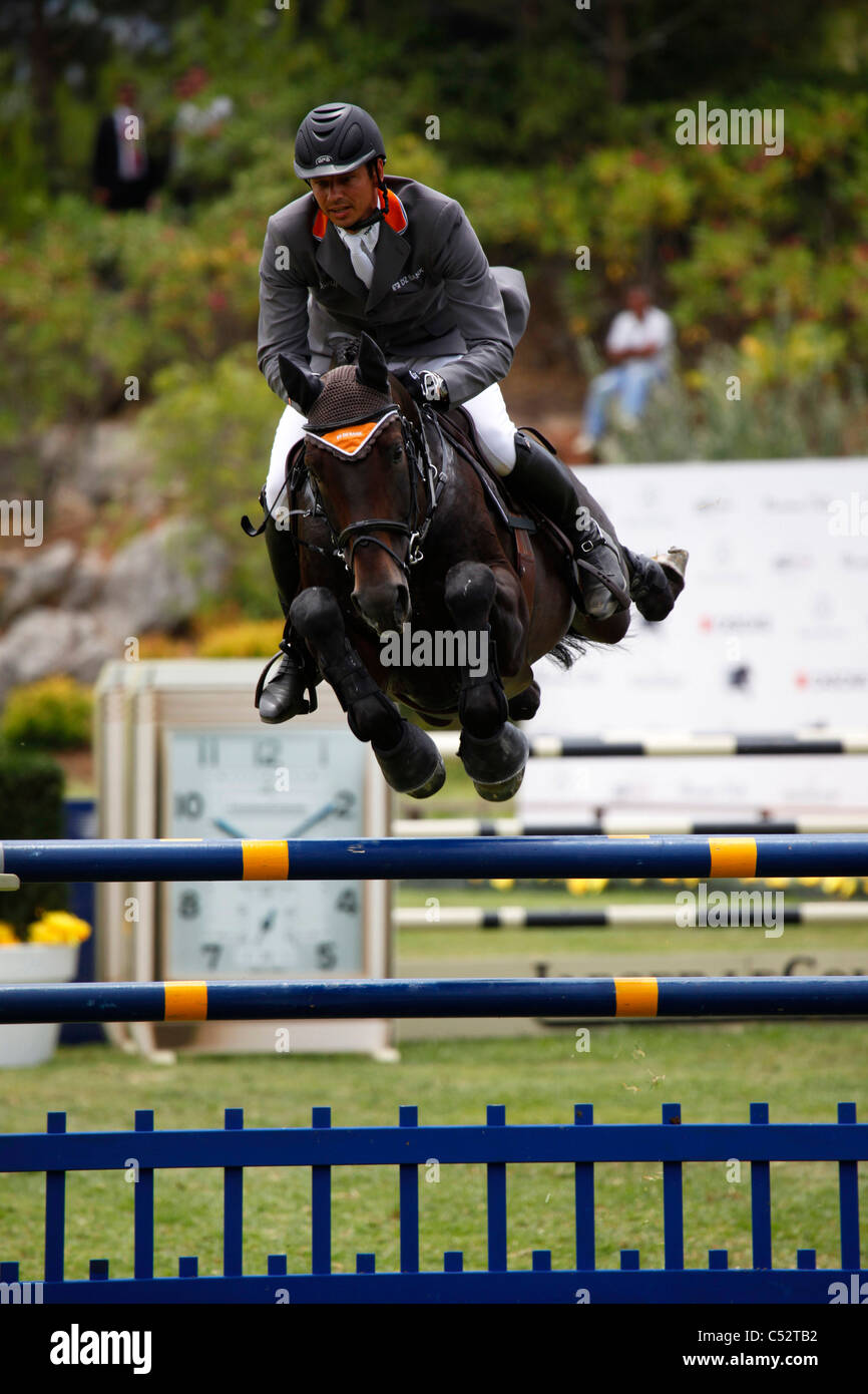 Marco Kutscher from Germany in action on the horse Satisfaction FRH. Stock Photo