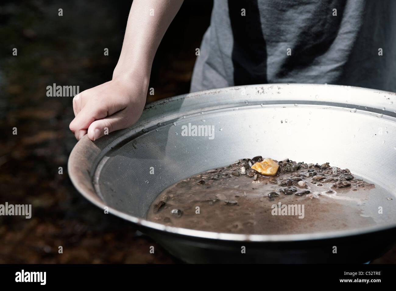 person panning for gold - Stock Image