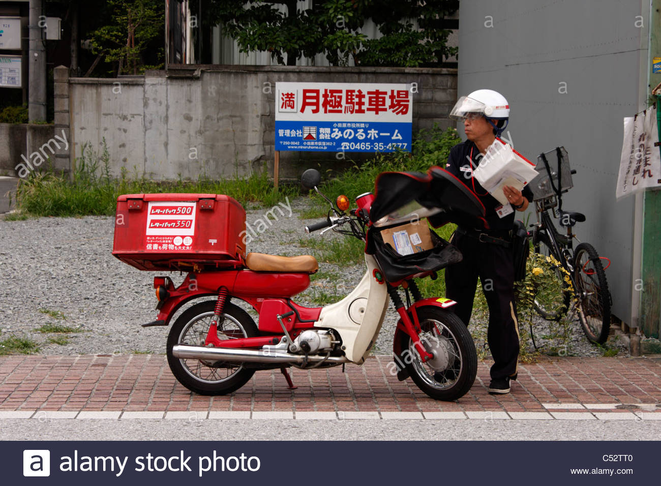 Postman sorting his delivery, Odawara, Japan - Stock Image