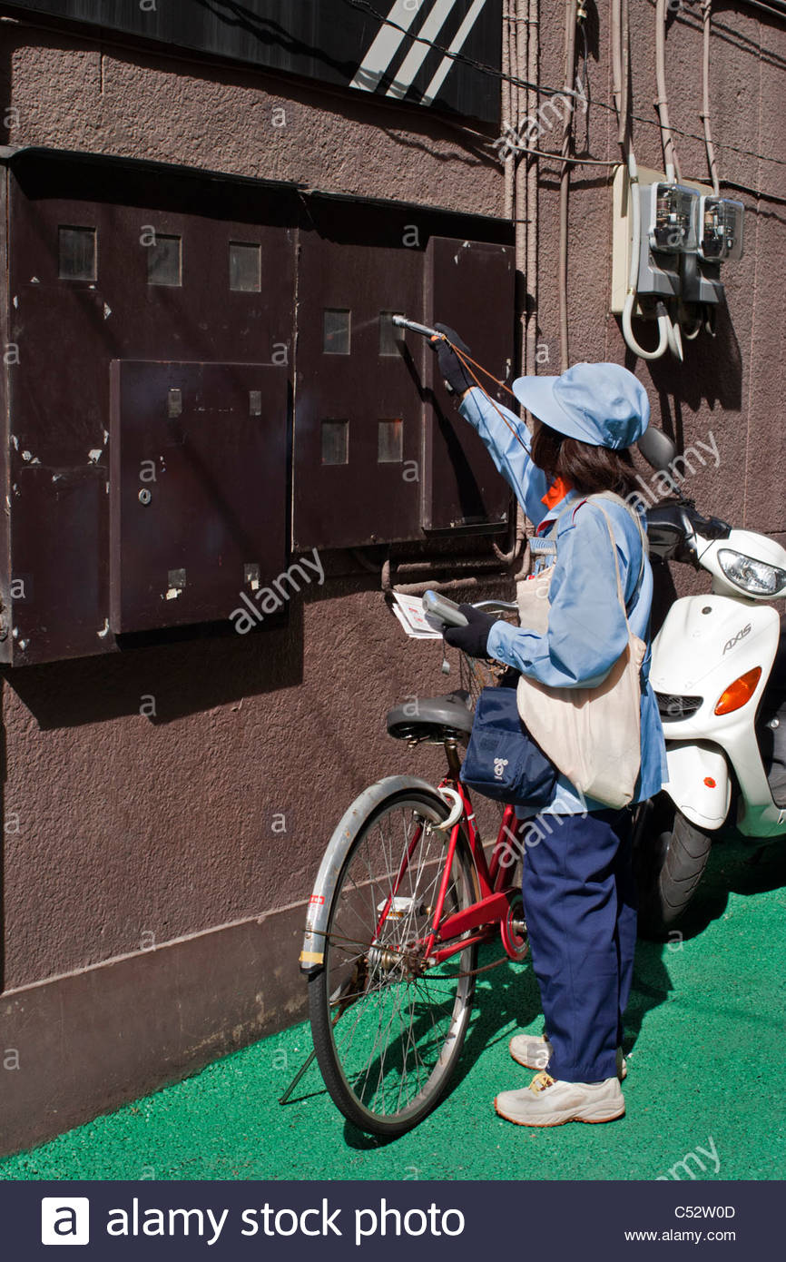 Reading electricity meters of a building in Funabashi, Japan - Stock Image