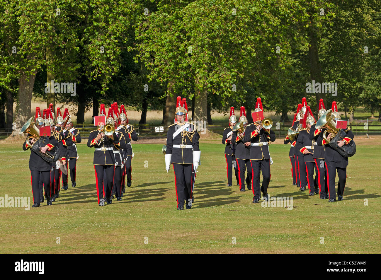 The military Band of the Blues and Royals playing and marching at a private royal function in Windsor Great Park. - Stock Image