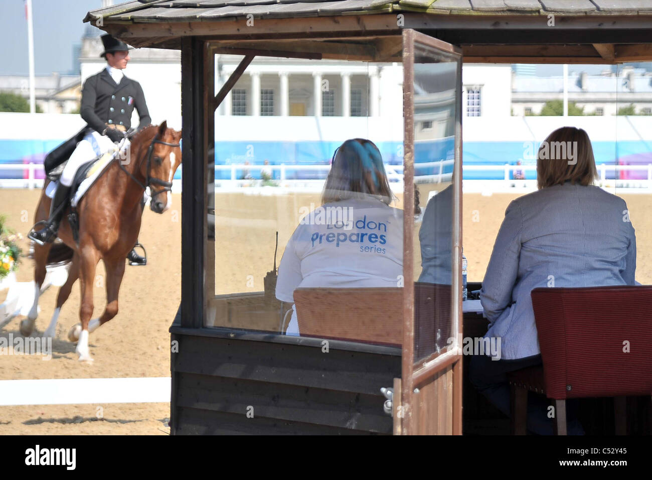 A rider goes past the judges box. Dressage. Greenwich Park Eventing Invitational. London Prepares Series. London - Stock Image
