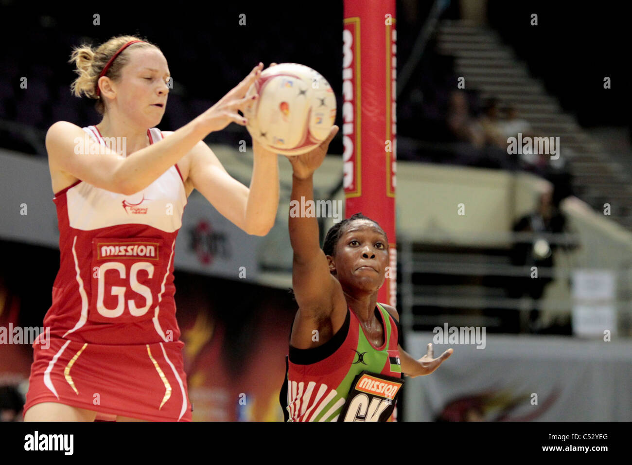 Towera Vimkhumbo of Malawi(right) fails to intercept the pass to Joanne Harten during the Pool D match - Stock Image