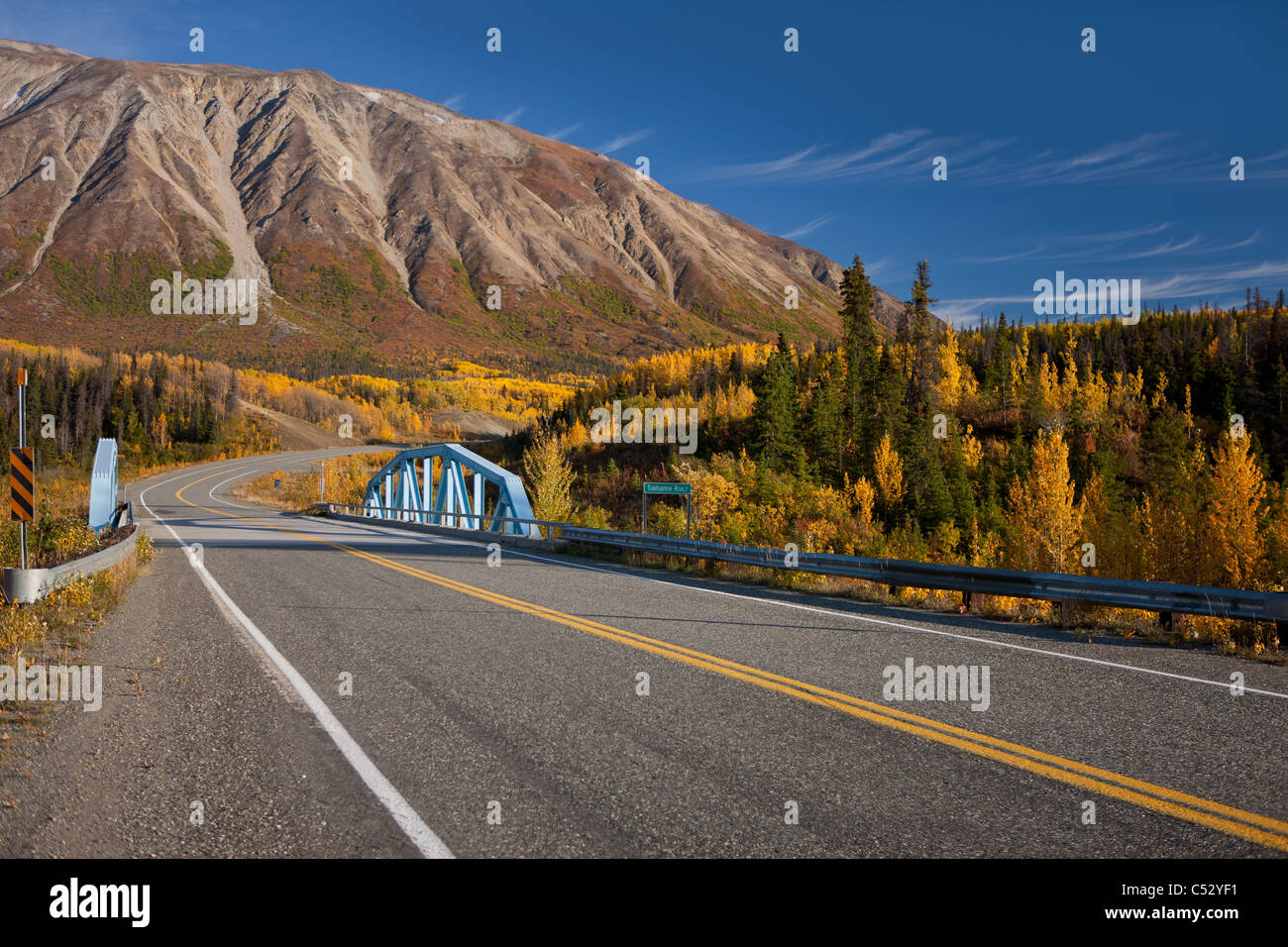 Scenic Autumn view along the Alaska Highway at the Takhanne River Bridge, Yukon Territory, Canada - Stock Image