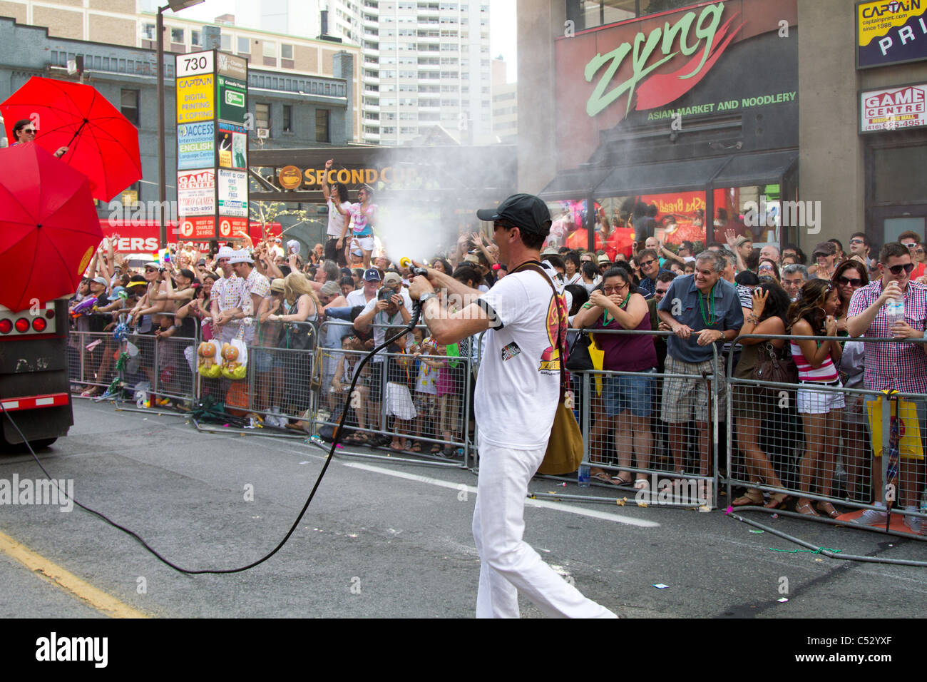'water gun' splash splashing crowd pride parade - Stock Image