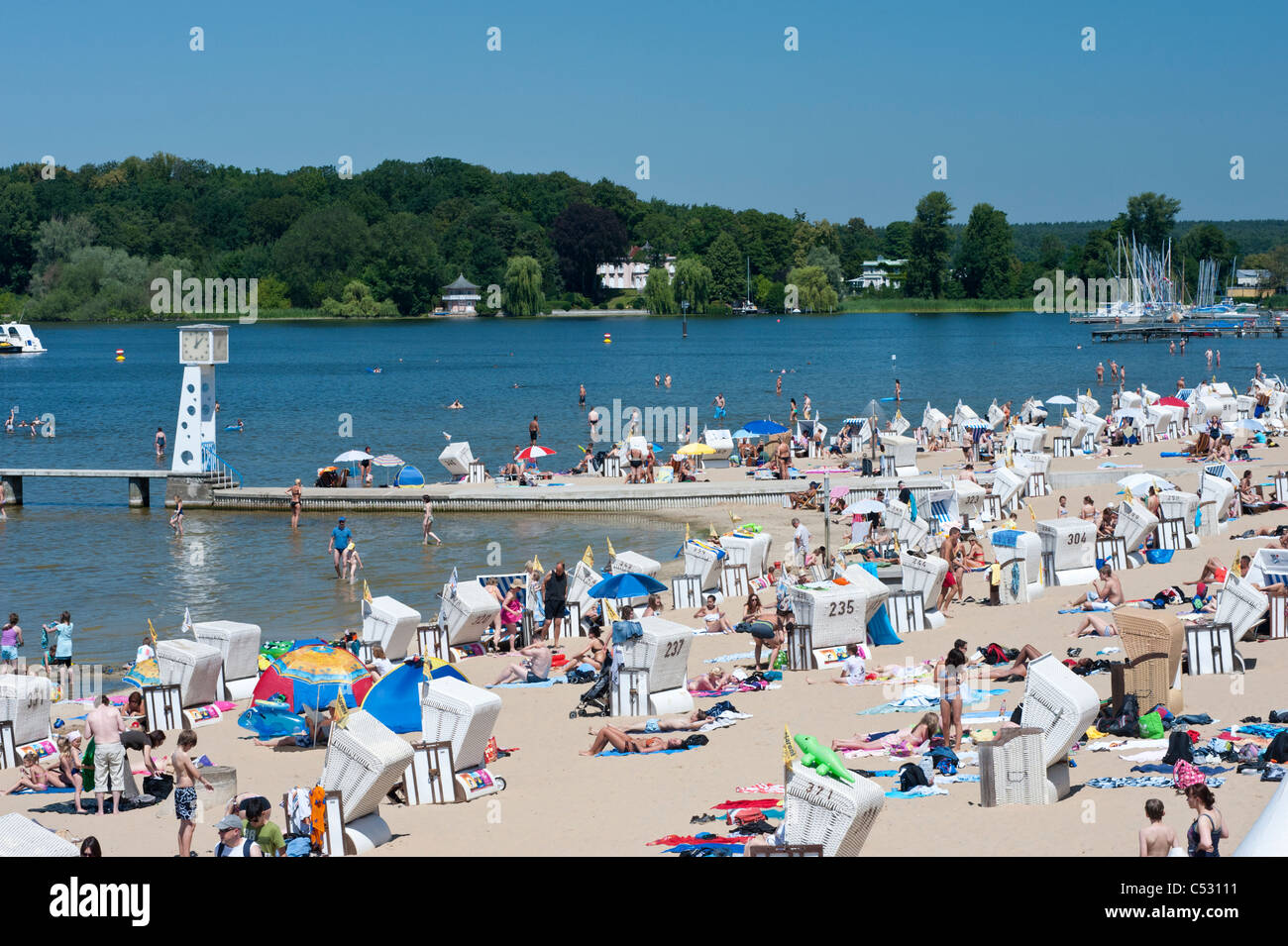 Busy beach at Strandbad in Wannsee in Berlin Germany - Stock Image