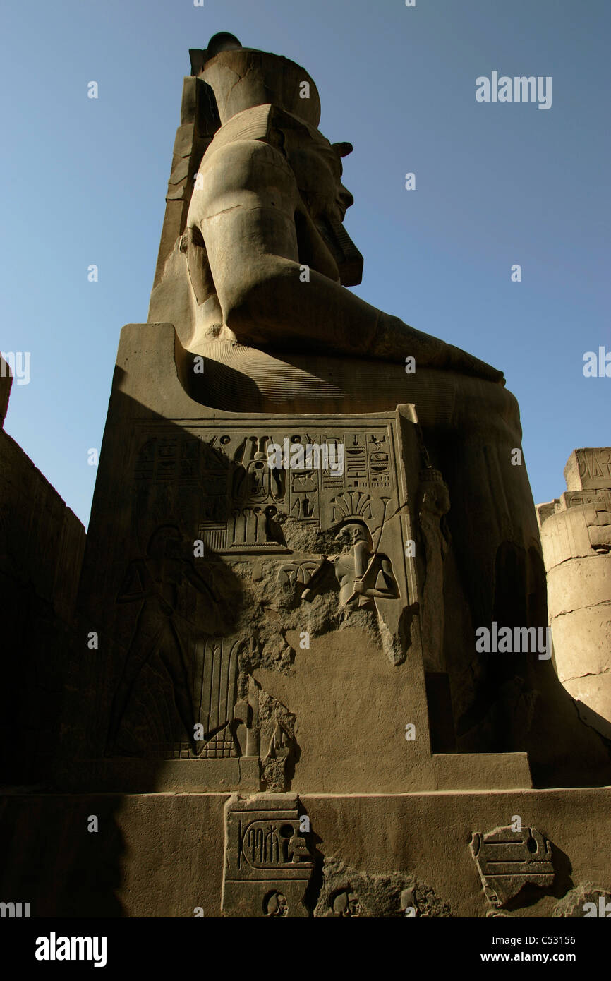 Hieroglyphics carved on the side of the statue of Rameses II in the Temple of  Luxor, Egypt - Stock Image