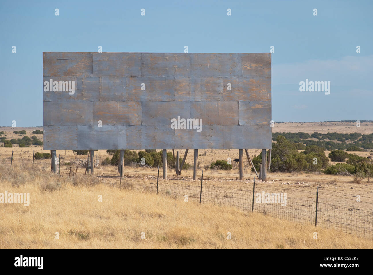 An empty billboard awaits a creative advertisement on the side of the road in rural New Mexico. - Stock Image
