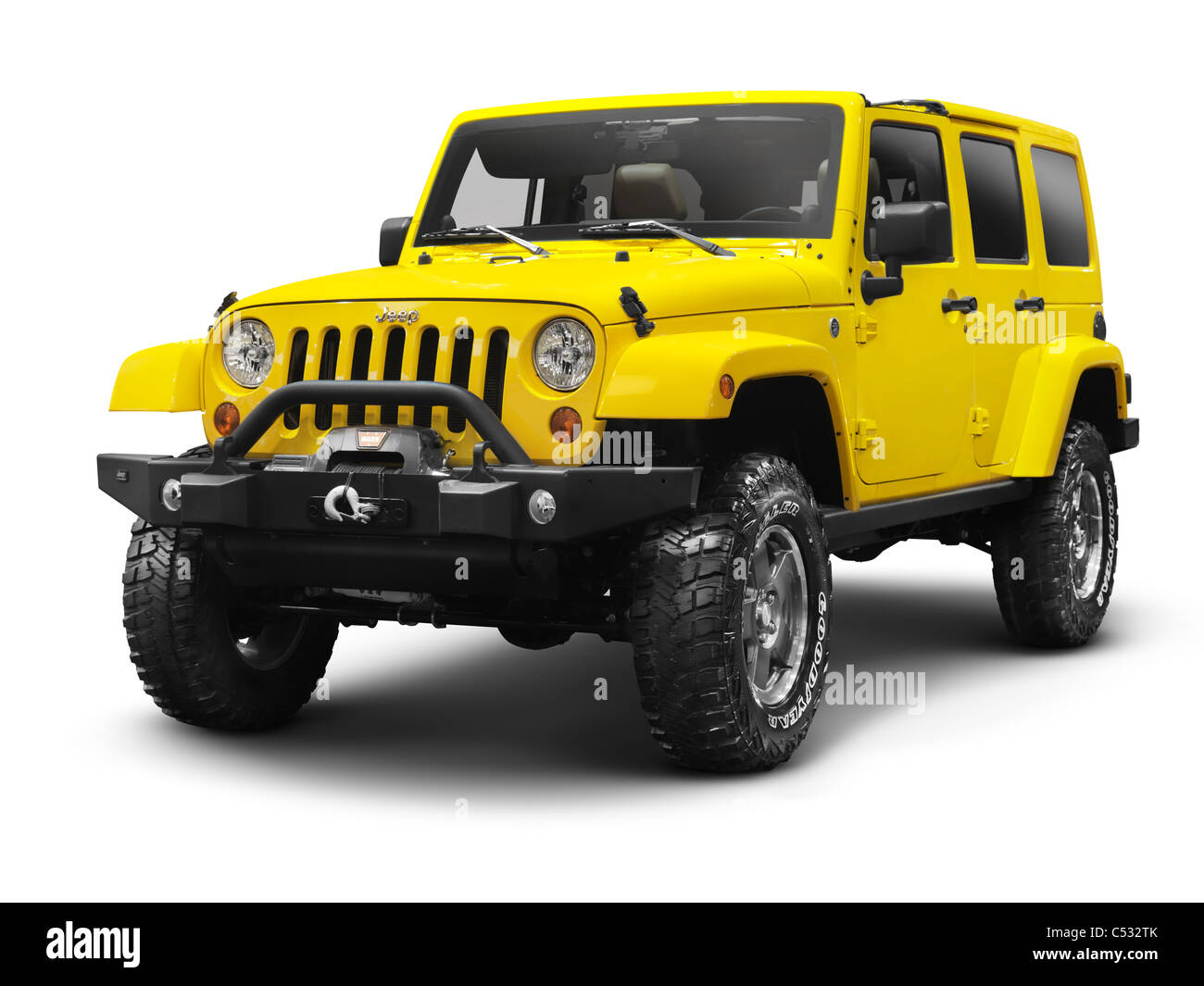 Yellow 2011 Jeep Wrangler Unlimited Sahara 4x4 SUV isolated on white background with clipping path - Stock Image