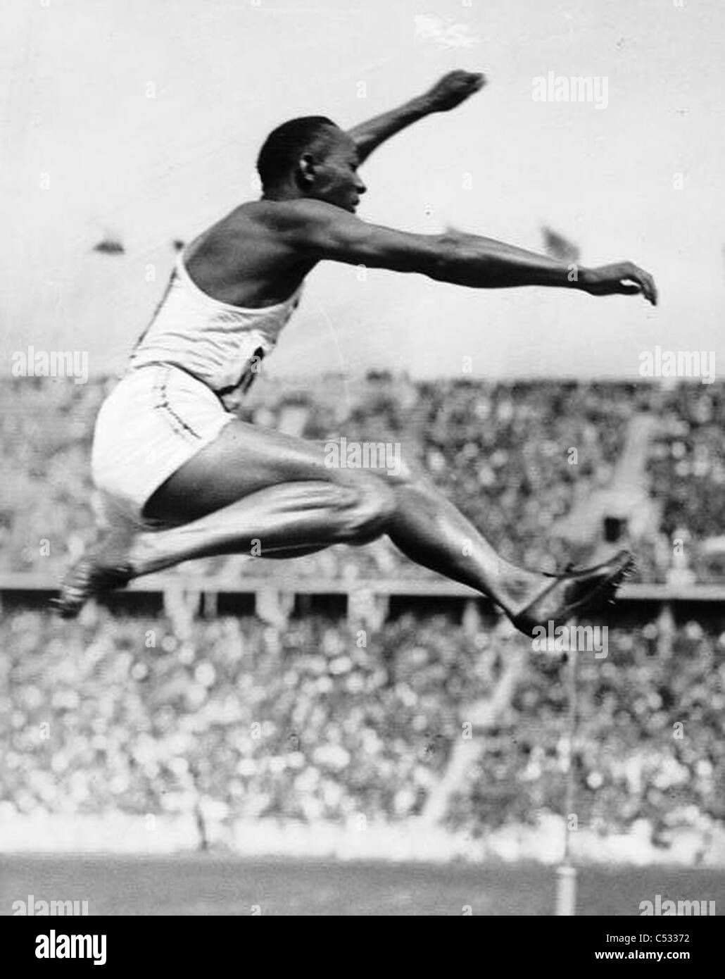 """JAMES """"JESSIE"""" OWENS (1913-1980) American athlete at the 1936 Summer Olympic Games where he won four gold medals Stock Photo"""