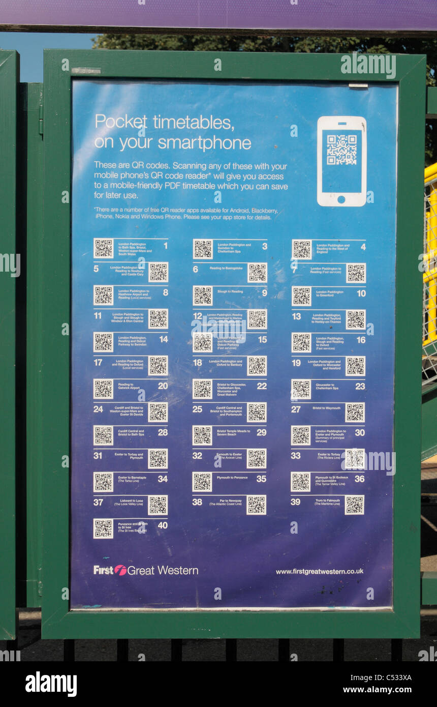 QR (Quick Response) smartphone codes for train timetables outside Dorchester West mainline station, Dorset, UK. - Stock Image