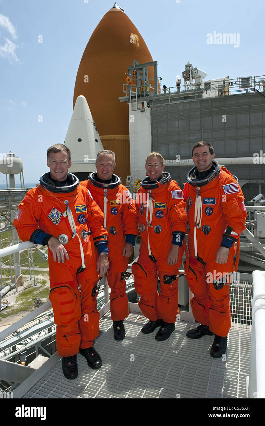 The final mission of Space Shuttle crew Atlantis pose for a picture on the launch pad of Kennedy Space Center - Stock Image