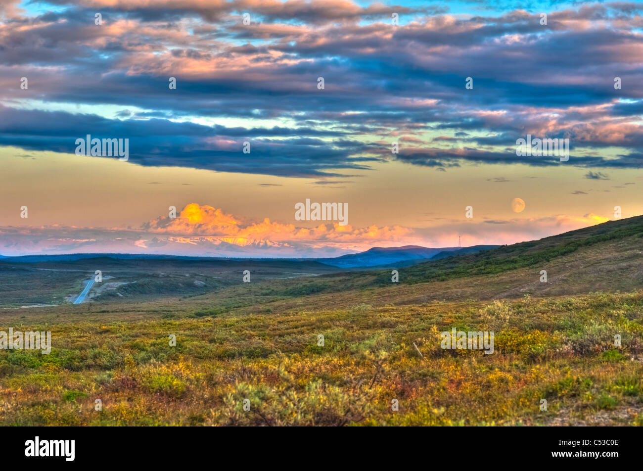 Moon rising and Mount Drum at sunset along the Denali Highway, Southcentral Alaska, Autumn. HDR - Stock Image