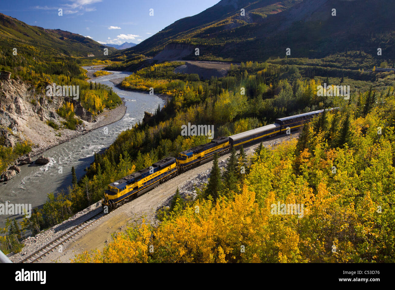 Alaska Railroad passenger train travels along the Nenana River before crossing under the Parks Highway near Mile - Stock Image