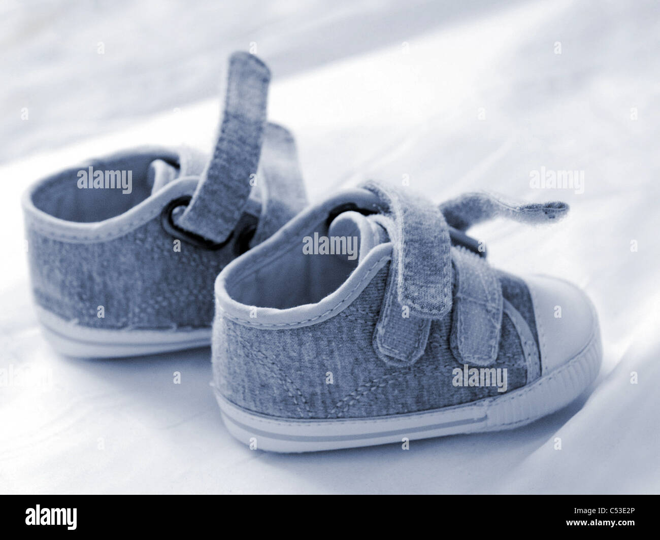 The shoes of a newborn baby boy. - Stock Image