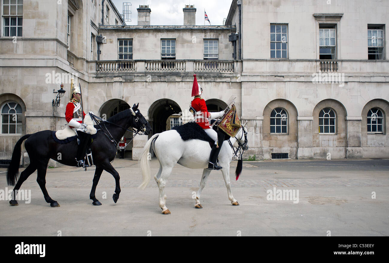 Mounted troopers of the Household Cavalry entering the courtyard of Horse Guards in London. Stock Photo