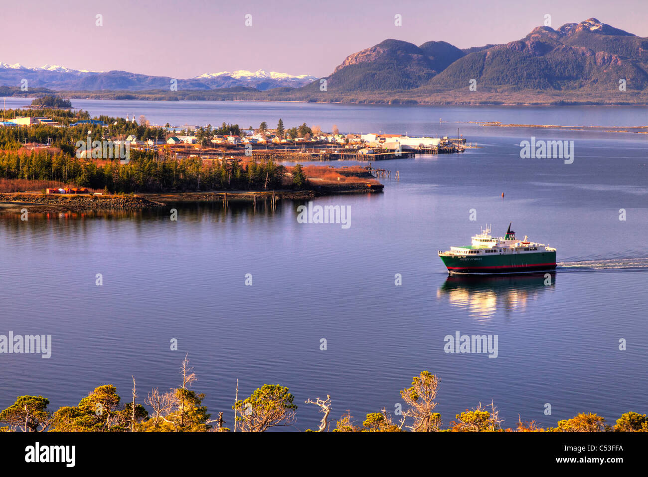 View of Metlakatla, Annette Island, and surrounding coastal area with a ferry in the foreground, Inside Passage, - Stock Image