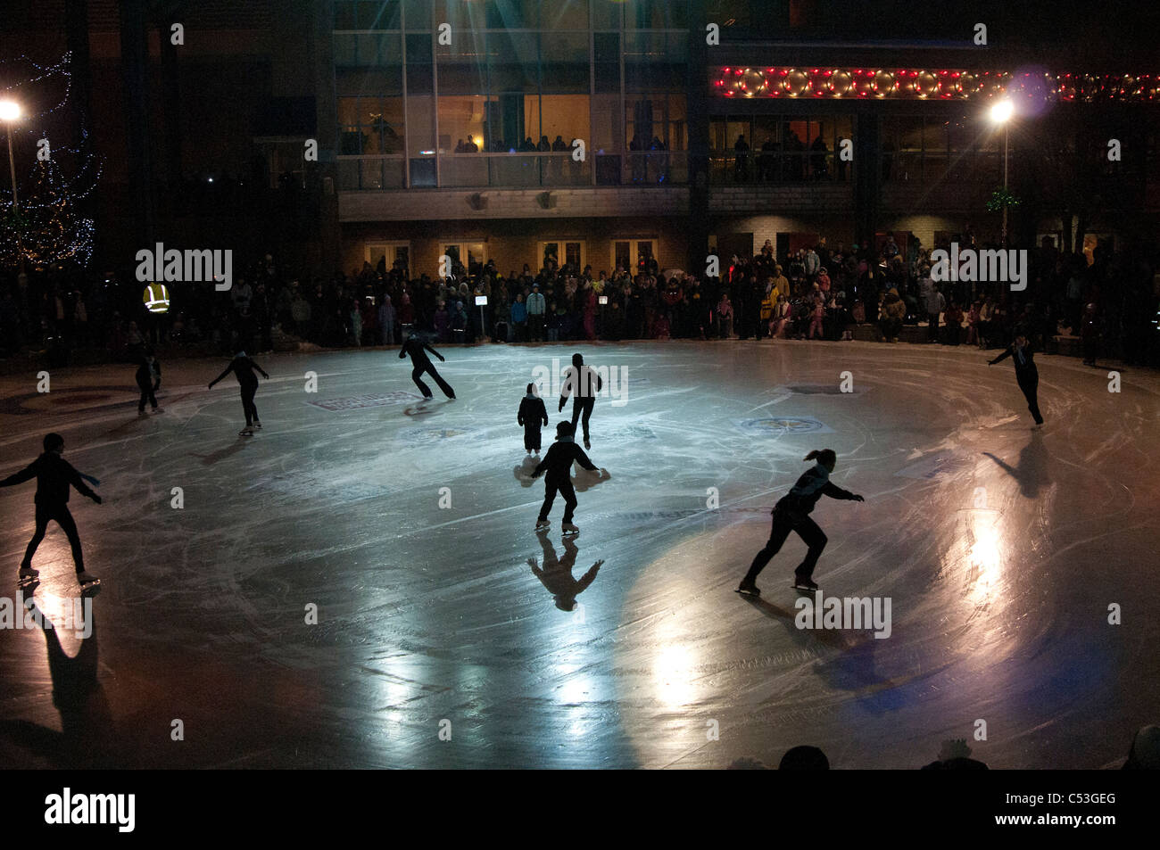 Ice skaters perform for the public on New Year's Eve in Town Square Park, downtown Anchorage, Southcentral Alaska, - Stock Image