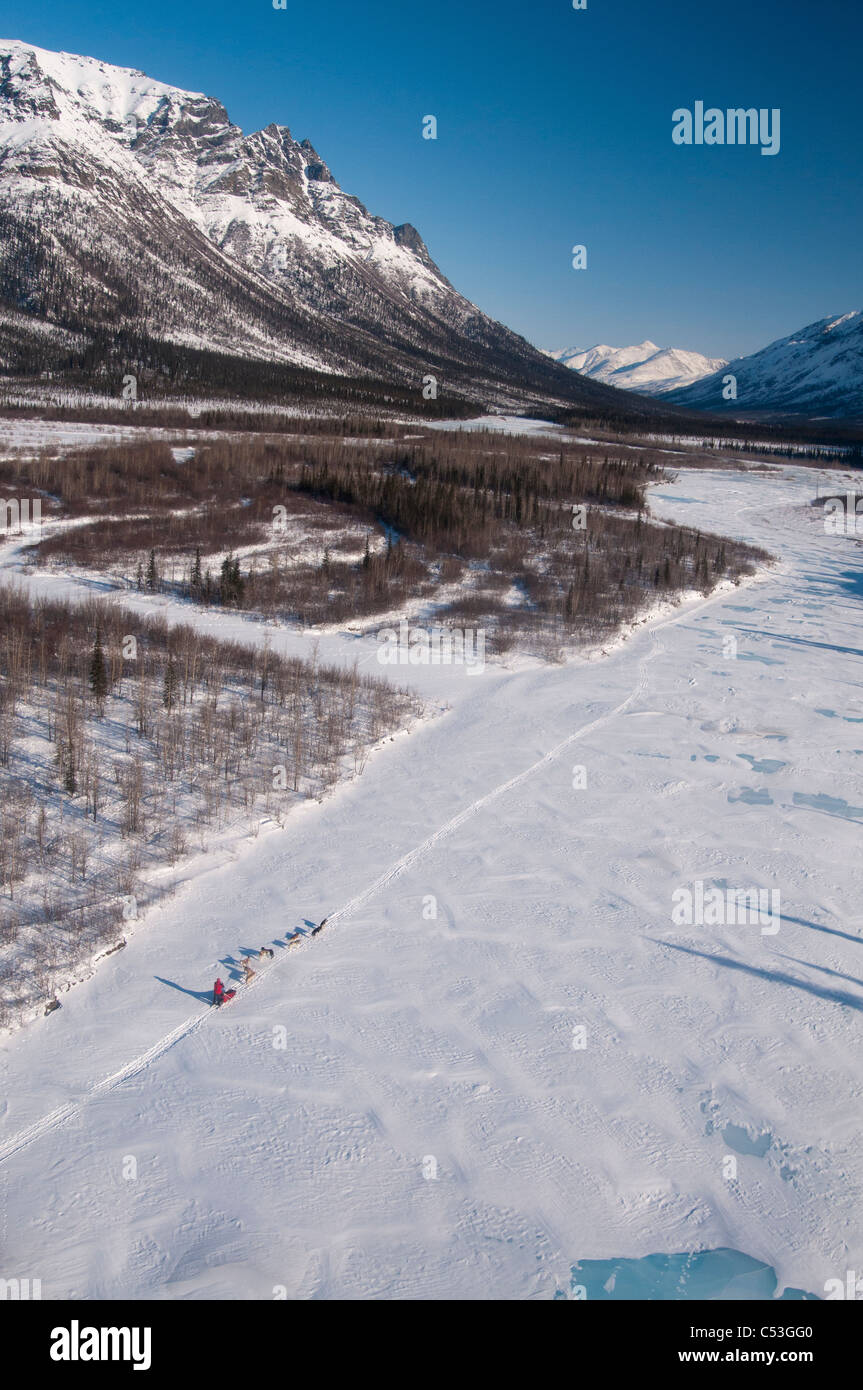 Aerial view of a dog team musing on the Koyukuk River in Gates of the Arctic National Park, Alaska - Stock Image