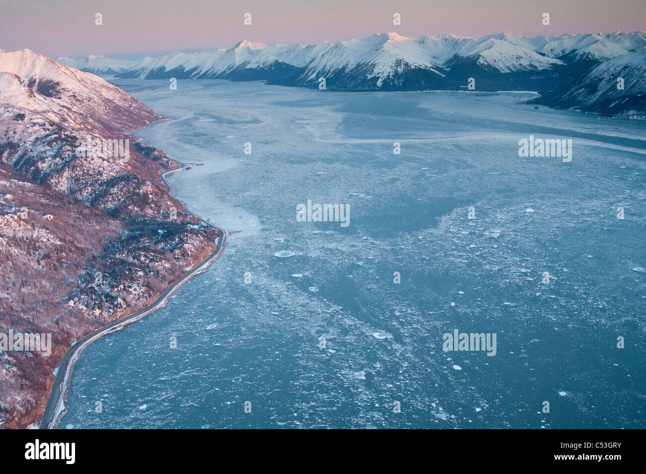 Aerial view of the Turnagain Arm and Seward Highway south of Anchorage, Southcentral Alaska, Winter - Stock Image
