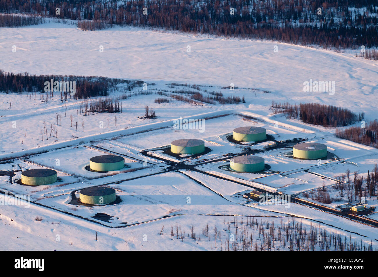 Aerial winter view of the Drift River oil terminal, located near the shores of Trading Bay in Cook Inlet, Alaska, - Stock Image