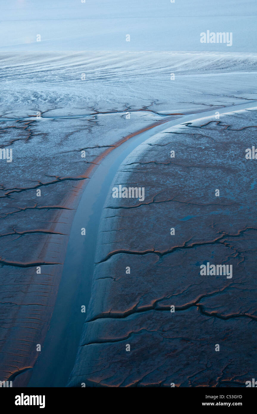 Aeral evening view of patterns in the mud flats of Cook Inlet near the Drift River, Southcentral Alaska, Winter - Stock Image