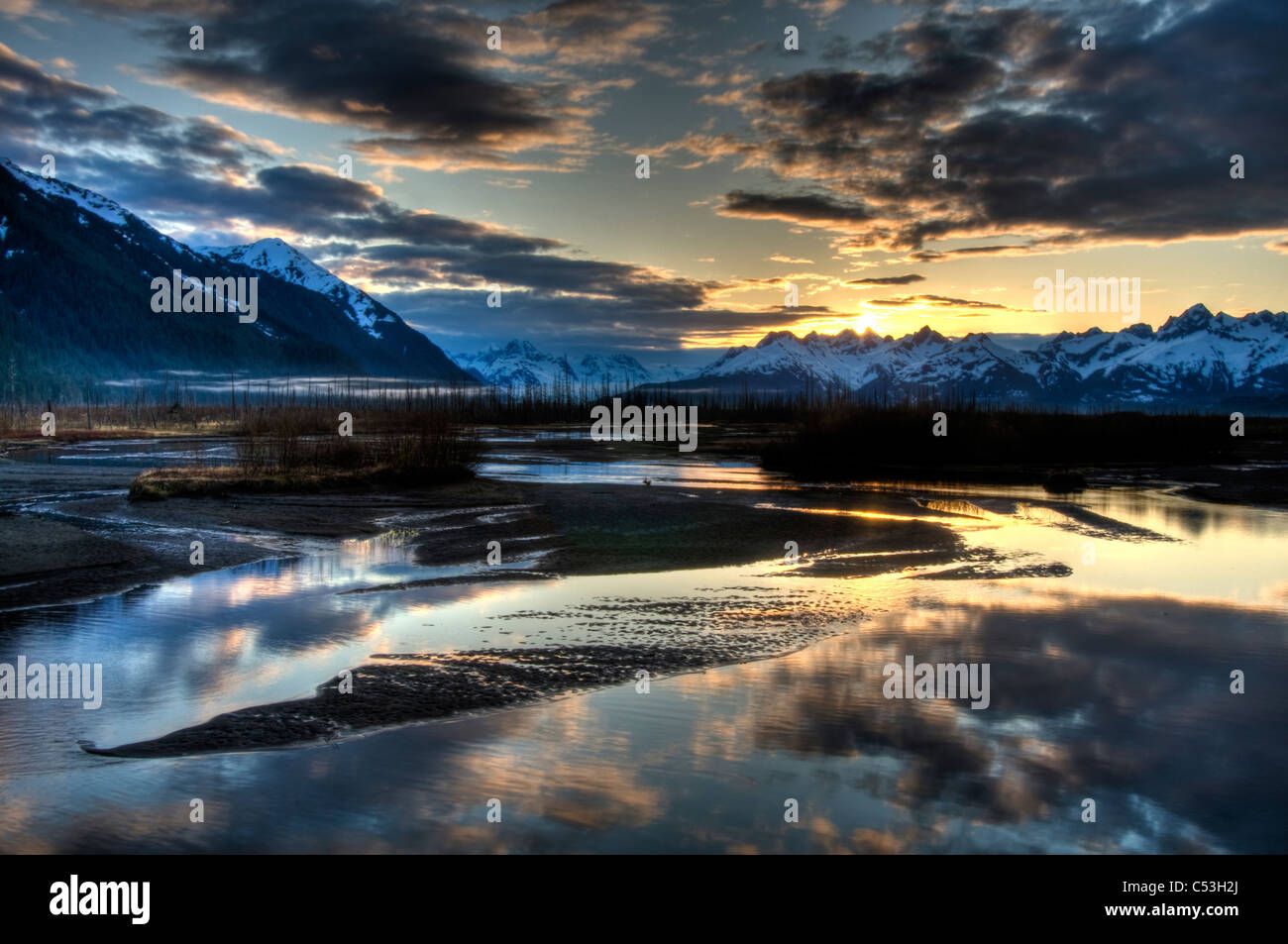 Morning light over the Chugach Mountains reflects in the braided Scott River in the Chugach National Forest, Alaska, - Stock Image