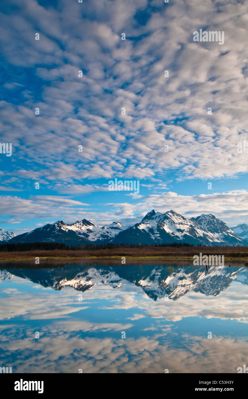 Alaganik slough reflects in the Chugach Mountains and cirrocumulus, Chugach National Forest, Cordova, Alaska Stock Photo