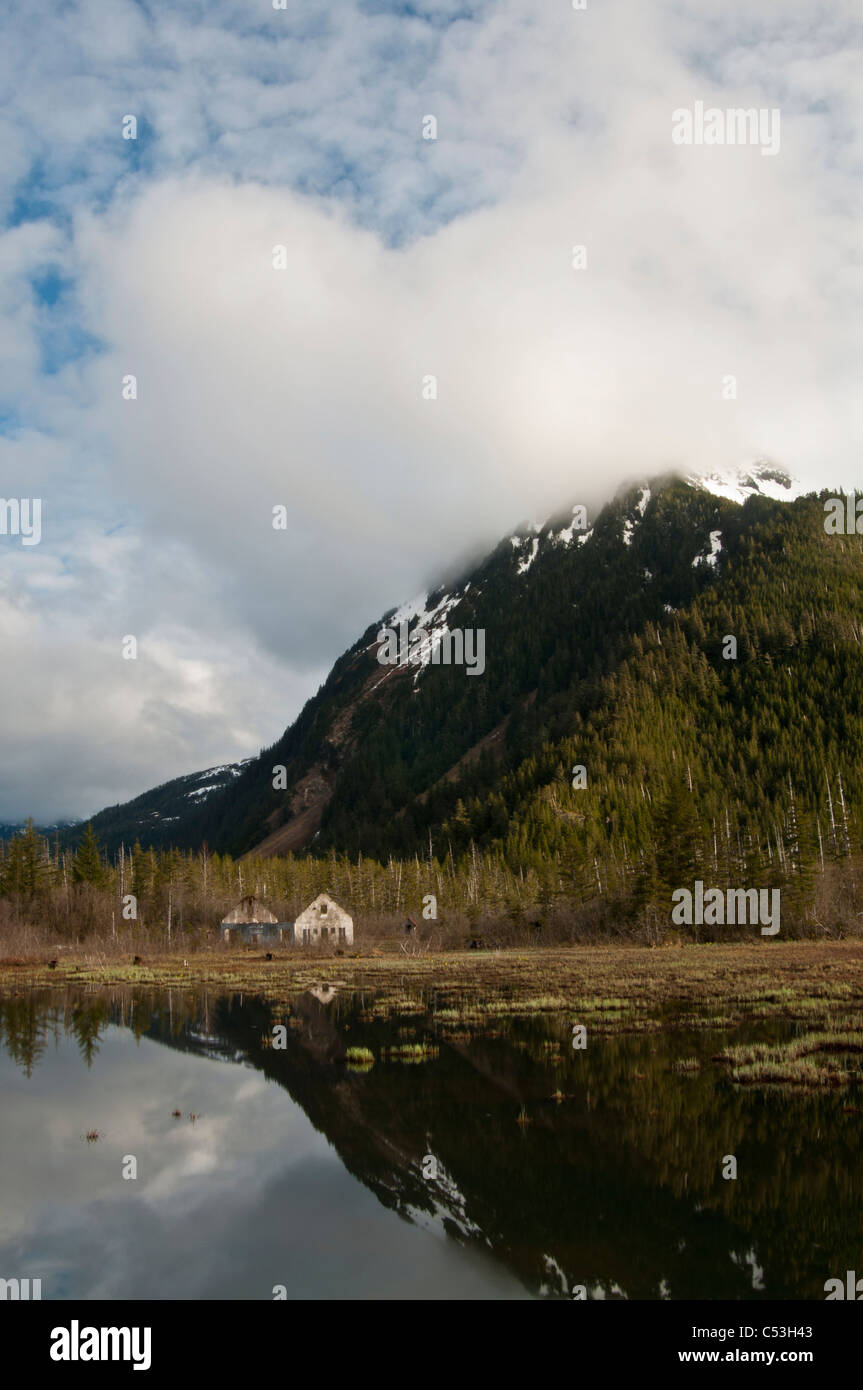 Old Eyak townsite with Chugach Mountains reflecting, Copper River Highway, Chugach National Forest, Cordova, Alaska - Stock Image