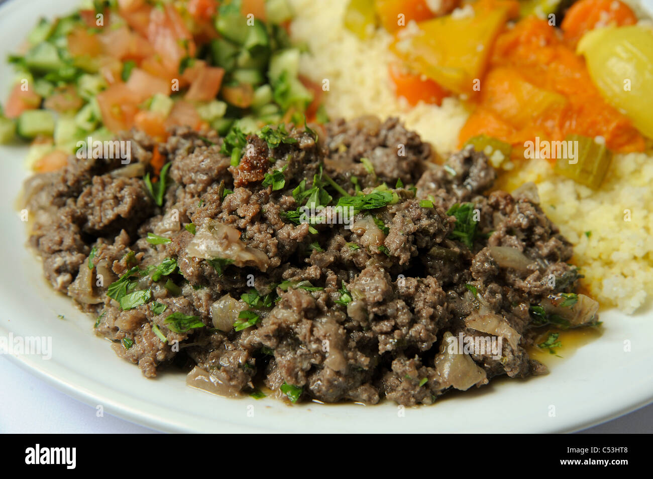 Couscous with vegetables and lamb - Stock Image