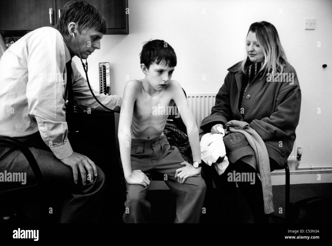 Patient visting a GP in his surgery. Liverpool, 1999. England, United Kingdom Stock Photo