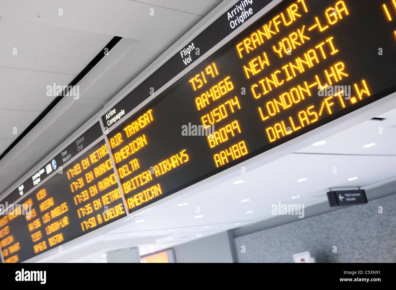 Toronto Pearson International airport arrivals board - Stock Image
