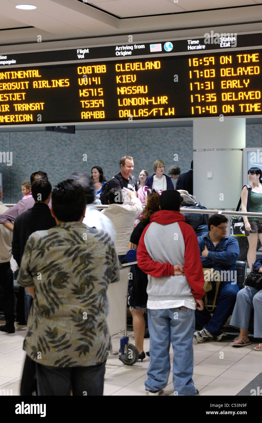 People waiting at arrivals hall of Toronto Pearson International airport. Ontario, Canada 2009. - Stock Image