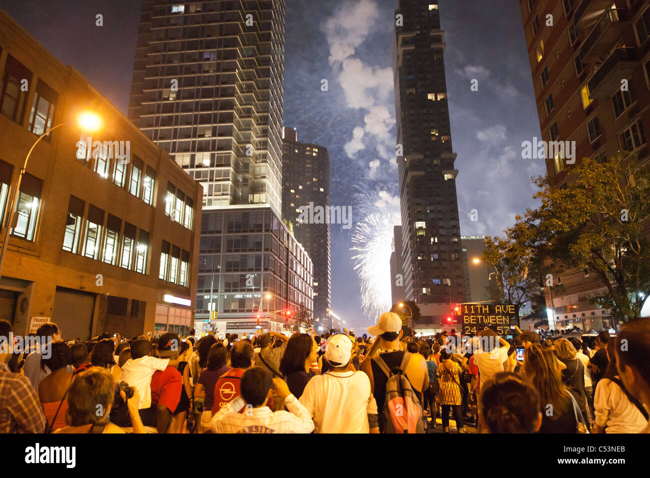Thousands of spectators line the streets in New York to view the 35th annual Macy's Fourth of July fireworks Stock Photo