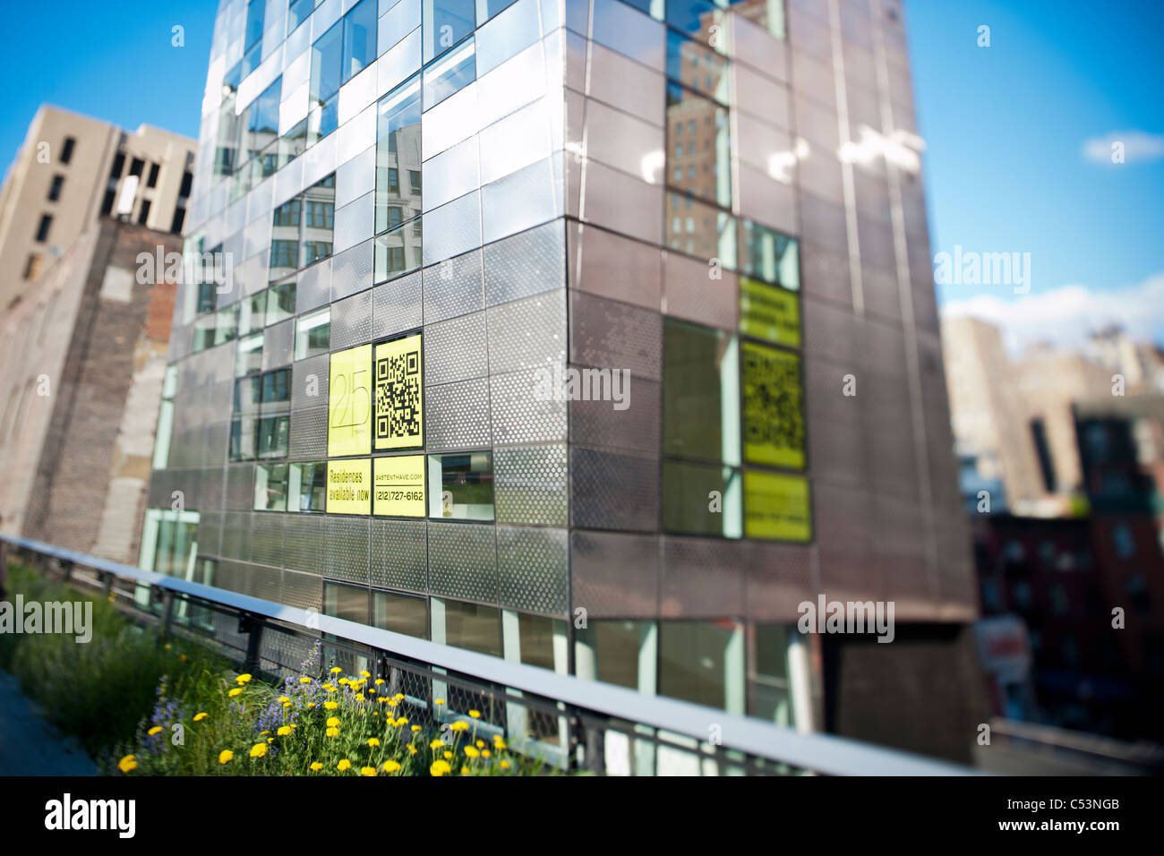 Real estate development featuring advertising using QR codes along the popular High Line Park in New York - Stock Image