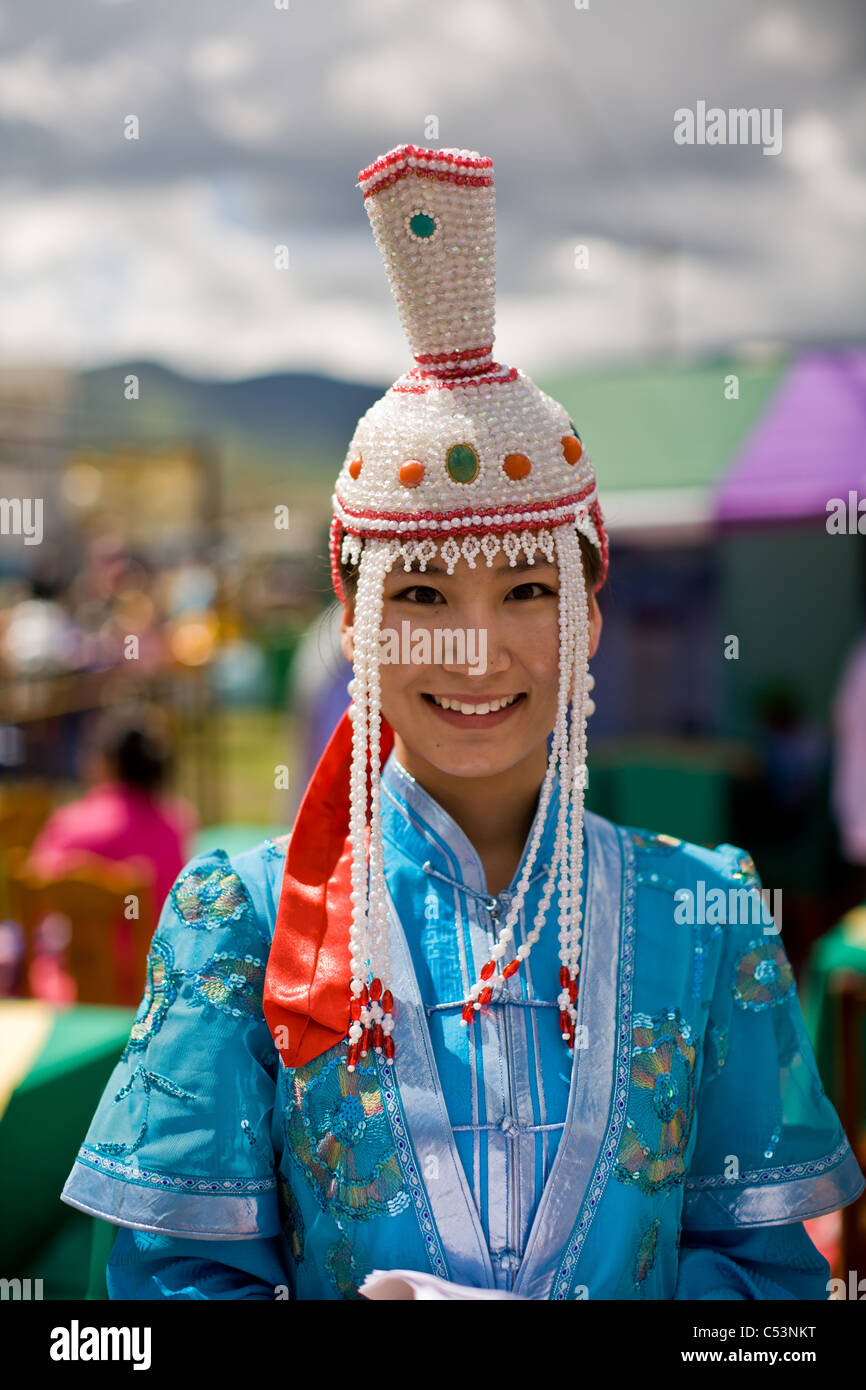 Young woman in traditional Mongolian dress during Nadaam Games festival on July 11, 2008 in Ulaanbaatar, Mongolia - Stock Image